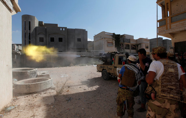 Members of Libyan forces allied with the UN-backed government fire a weapon towards Islamic State militants in neighbourhood Number One in central Sirte, Libya August 28, 2016. (Photo by Ismail Zitouny/Reuters)