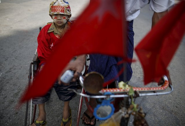 A boy sits on cart as National League for Democracy Party (NLD) supporters cycle during a campaign rally on the streets of Minglar Taung Nyunt township ahead of the upcoming general elections in Yangon, Myanmar September 27, 2015. (Photo by Soe Zeya Tun/Reuters)
