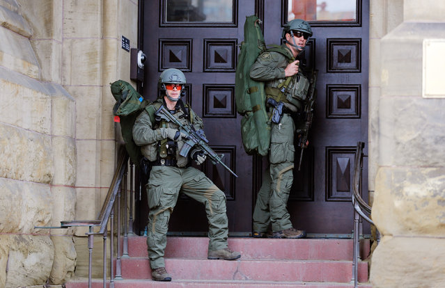 Armed RCMP officers guard the front of Langevin Block on Parliament Hill following a shooting incident in Ottawa October 22, 2014. (Photo by Chris Wattie/Reuters)