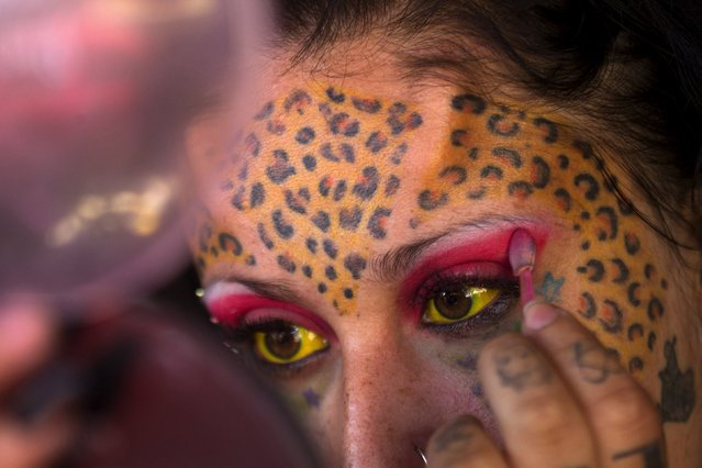 Body modification and tattoo artist Andrea Aguilar, 26, known as leopard woman, at the Quito Tattoo Convention shows off her work during the last day of the event in Quito, Ecuador September 27, 2015. (Photo by Guillermo Granja/Reuters)