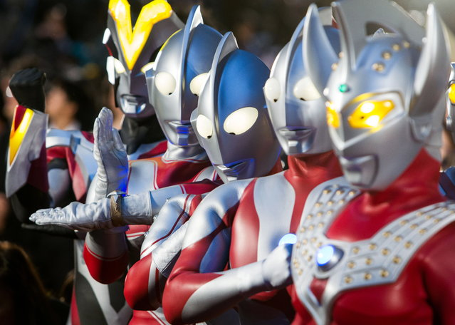 Performers dressed Ultraman characters attend the opening red carpet event of the 27th Tokyo International Film Festival (TIFF), in Tokyo, Japan, October 23, 2014. The TIFF will show a variety of film screenings until 31 October. (Photo by Christopher Jue/EPA)