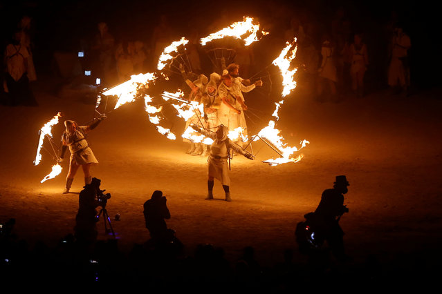 Participants perform with fire as approximately 70,000 people from all over the world gather for the 30th annual Burning Man arts and music festival in the Black Rock Desert of Nevada, U.S. September 3, 2016. (Photo by Jim Urquhart/Reuters)