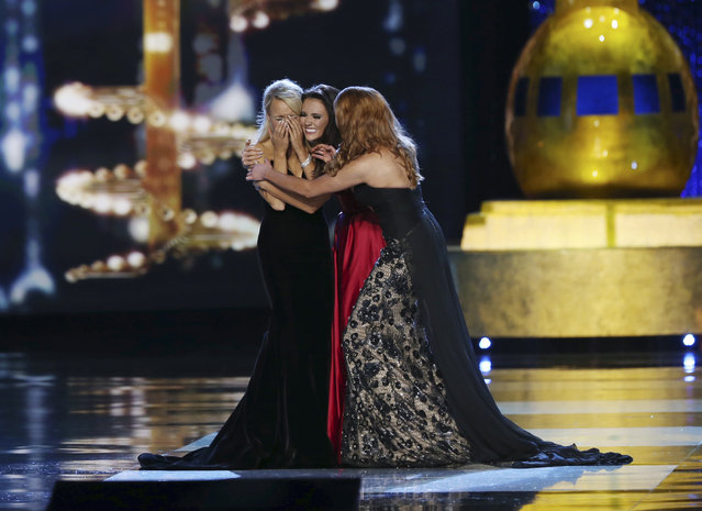 Miss Maryland Hannah Brewer, center, and Miss Texas Caroline Carothers, right, congratulate Miss Arkansas Savvy Shields as Miss America during the Miss America 2017 pageant, Sunday, September 11, 2016, in Atlantic City, N.J. (Photo by Mel Evans/AP Photo)