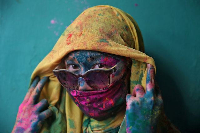 A woman poses for a photograph during Holi celebrations in the town of Barsana in the state of Uttar Pradesh, India, March 6, 2017. (Photo by Cathal McNaughton/Reuters)