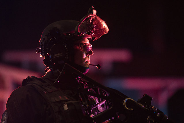 Portland police are seen in riot gear during a standoff with protesters in Portland, Oregon on August 16, 2020. Protests have continued for the 80th consecutive night in Portland since the killing of George Floyd. (Photo by Paula Bronstein/Getty Images)