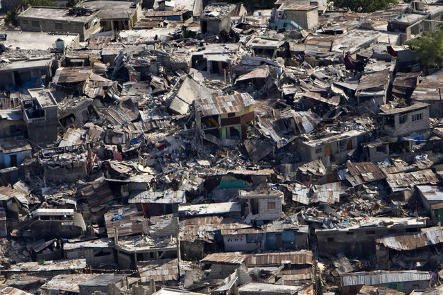 A poor neighbourhood shows the damage after an earthquake measuring 7.0 rocked Port-au-Prince,  the Haitian capital just before 5 pm yesterday, on January 13, 2010 in Port-au-Prince, Haiti. (Photo by Logan Abassi/MINUSTAH via Getty Images)