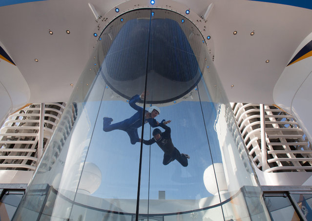 People use the skydiving simulator onboard the cruise ship Quantum of the Seas which is currently docked at Southampton on October 31, 2014 in Southampton, England. (Photo by Matt Cardy/Getty Images)