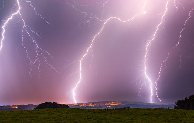 Lightning over Alnwick in Northumberland in the early hours of September 16th, 2016. The Met Office issued an amber weather warning, the second highest alert, for the East of England, London and the South East. (Photo by Calum Gladstone/Bav Media)
