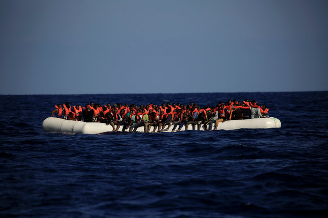 An overcrowded dinghy with migrants from different African countries is seen after members of the German NGO Jugend Rettet guided them towards the Iuventa vessel during a rescue operation, off the Libyan coast in the Mediterranean Sea  September 21, 2016. (Photo by Zohra Bensemra/Reuters)