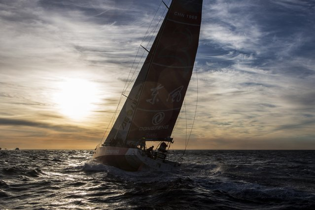 In this handout image provided by the Volvo Ocean Race, Team Dongfeng at the start of Leg 2 from Cape Town to Abu Dhabi on November 19, 2014 in Cape Town, South Africa.(Charlie Shoemaker/Volvo Ocean Race via Getty Images)