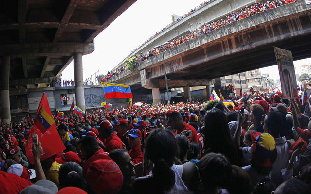 Viaducts and streets were packed for the passage of the procession of Chávez. (Photo by Carlos Garcia Rawlins/Reuters)