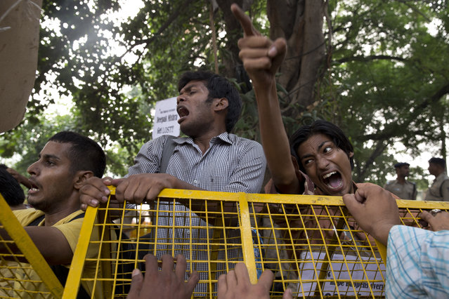 Indian students shout slogans during a protest against the latest incidents of rape in New Delhi, India, Sunday, October 18, 2015. Police arrested two teenagers Sunday for allegedly raping a toddler in New Delhi, in the latest incident of sexual violence against a young child in the Indian capital. In a separate incident, police on Saturday arrested three men for raping a 5-year-old in an east Delhi suburb. (Photo by Tsering Topgyal/AP Photo )