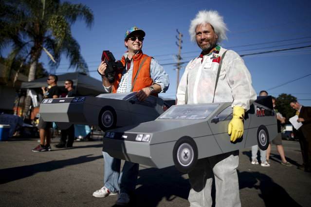 """People portraying characters from the film """"Back to the Future Part II"""" stand outside the Burger King featured in the movie, in Los Angeles, California, October 21, 2015. (Photo by Lucy Nicholson/Reuters)"""