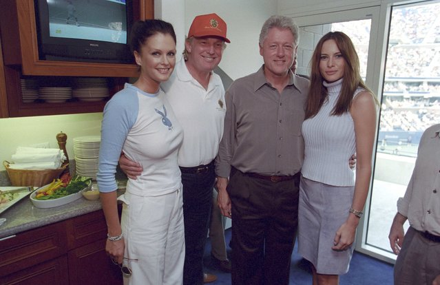 Donald Trump (2ndL) and his wife Melania (R) pose with then U.S. President Bill Clinton and model Kylie Bax at the U.S. Open in Flushing, New York, U.S., in this September 8, 2000 handout photo. (Photo by Reuters/Courtesy William J. Clinton Presidential Library)
