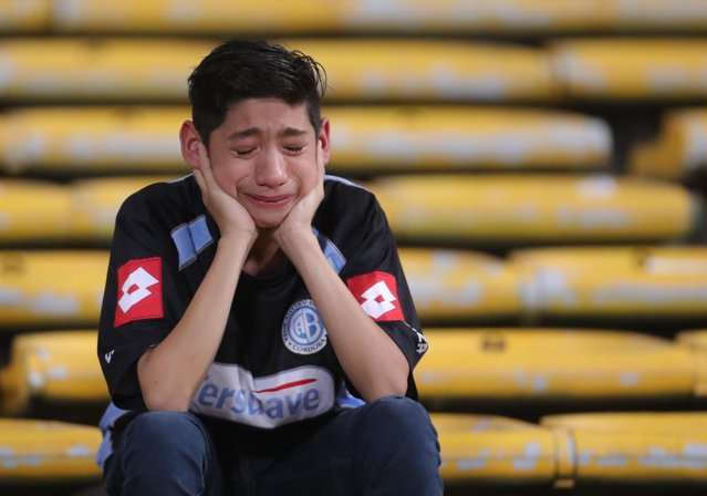A fan cries after argentina's Belgrano lost it's match against Brazil's Coritiba during a Copa Sudamericana soccer match in Cordoba, Argentina, Thursday, September 29, 2016. (Photo by Nicolas Aguilera/AP Photo)