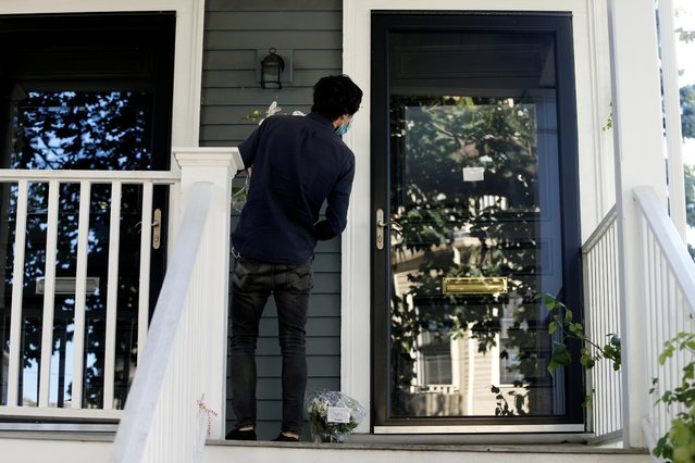 A man delivers flowers, after American poet Louise Gluck won the 2020 Nobel Prize for Literature, at her home in Cambridge, Massachusetts, U.S. October 8, 2020. (Photo by Katherine Taylor/Reuters)