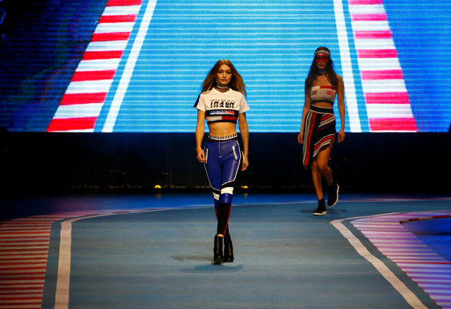 A model presents a creation from the Tommy Hilfiger Autumn/Winter 2018 women collection during Milan Fashion Week in Milan, Italy February 25, 2018. (Photo by Tony Gentile/Reuters)
