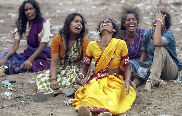 Women mourn during the burial of victims killed in a tsunami in Cuddalore, south of the southern Indian city of Madras in this December 27, 2004 file photo. (Photo by Arko Datta/Reuters)