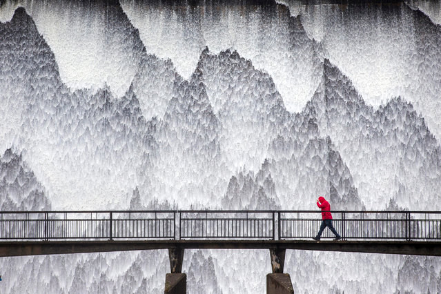 """""""Dam Wet"""". Water cascades down the 21-metre high dam wall at Wet Sleddale in Cumbria.. (Photo by Andrew McCaren/Royal Meteorological Society's Weather Photographer of the Year Awards)"""