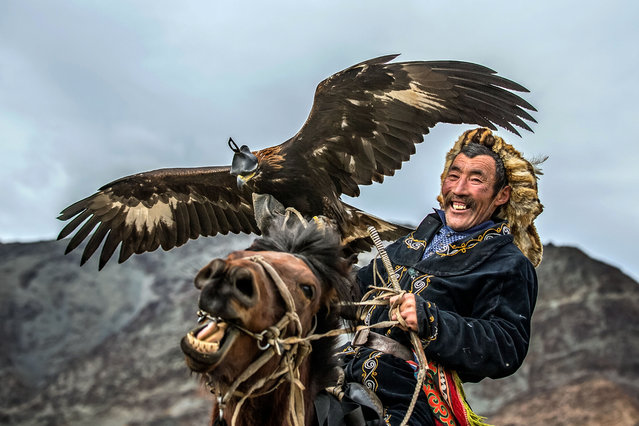 "He said: ""The photos were taken during the 17th Golden Eagle Festival in the Bayan-Ulgii province in Altai Mountains of Western Mongolia and the festival is just amazing"". (Photo by Batzaya Choijiljav/Caters News)"