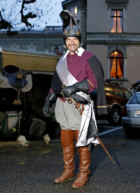 A  member of Compagnie 1602 playing the role of a horseman poses before a procession in Geneva December 14, 2014. (Photo by Pierre Albouy/Reuters)