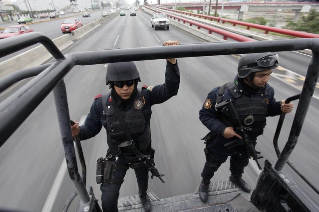 Members of the Fuerza Civil (Civil Force) police patrol during a media presentation to show the police model that the federal government wants for the rest of the country, in Monterrey December 17, 2014. (Photo by Daniel Becerril/Reuters)