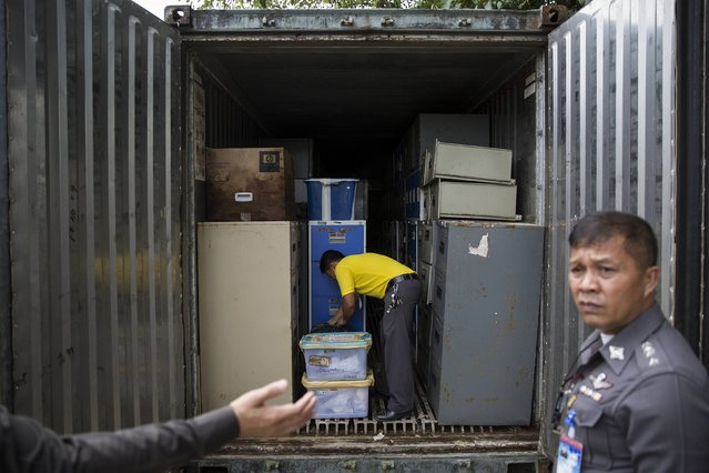 Boxes with personal possessions of 2004 tsunami victims are put back into a container outside a police station in Takua Pa, in Phang Nga province December 19, 2014. (Photo by Damir Sagolj/Reuters)