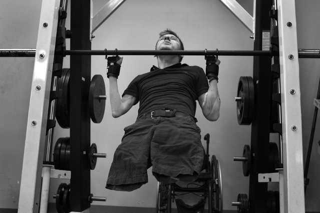 Former U.S. Army Sgt. Brendan Marrocco, does pull-ups  during therapy at Walter Reed National Military Medical Center  on May 2, 2014 in Bethesda, Maryland. An Irag war veteran, Morrocco, lost both arms and legs by an IED in 2009; received double arm transplants at Johns Hopkins Hospital two years ago, is still recovering and going through physical therapy at Walter Reed. (Photo by Michel du Cille/The Washington Post)