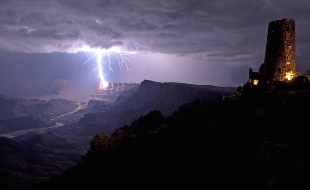 This is the incredible moment a fierce lightning bolt crashed against the Grand Canyon illuminating the steep canyon walls. Shrouded in darkness, the breath-taking landscape was shocked into life as mother nature sent the bolt storming down to Earth. (Photo by Travis Roe/U.S. Dept. of the Interior/Caters News)