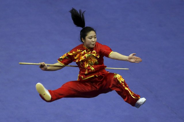 Amy Li of the U.S. competes in the women's nangun final during the 13th World Wushu Championship 2015 at Istora Senayan stadium in Jakarta, November 17, 2015. (Photo by Reuters/Beawiharta)