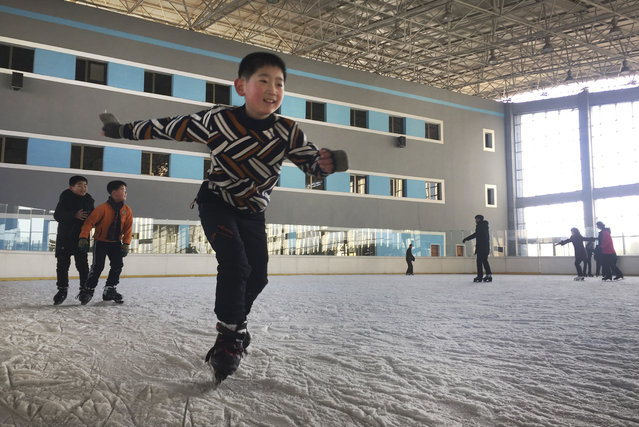 In this Thursday, February 1, 2018, photo, a boy enjoys ice skating at the Outdoor Skating Rink in Pyongyang, North Korea. Though not known as a winter sports power, North Korea will be joining in the Pyeongchang Games set to begin on Feb. 9. (Photo by Eric Talmadge/AP Photo)