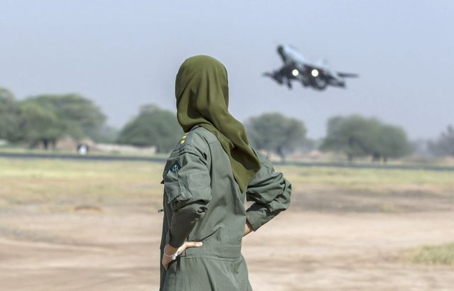 Ayesha Farooq, 26, Pakistan's only female war-ready fighter pilot watches an airforce jet about to take off at Mushaf base in Sargodha, north Pakistan June 7, 2013. (Photo by Zohra Bensemra/Reuters)