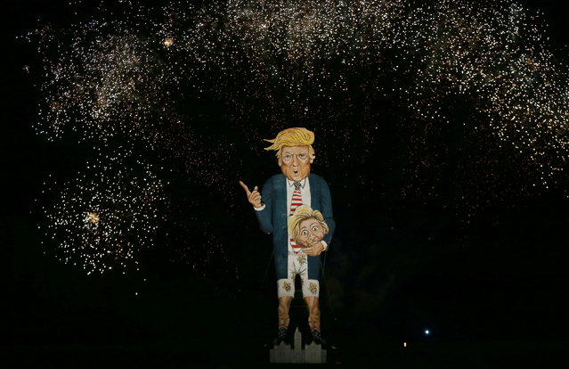 Fireworks explode around an effigy of U.S. Republican presidential candidate Donald Trump during bonfire night celebrations in Edenbridge, Britain November 5, 2016. (Photo by Neil Hall/Reuters)