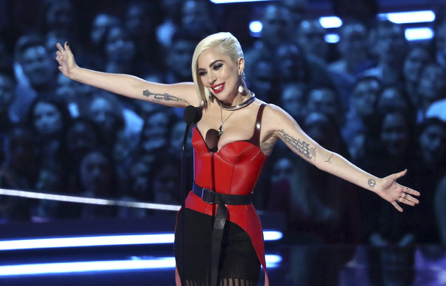 In this Saturday, June 16, 2018, photo, Lady Gaga presents the award for best movie at the MTV Movie and TV Awards at the Barker Hangar in Santa Monica, Calif. (Photo by Matt Sayles/Invision/AP Photo)
