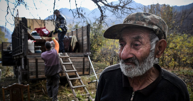 Armenians pack their belongings while leaving their house in the town of Kalbajar on November 12, 2020, during the military conflict between Armenia and Azerbaijan over the breakaway region of Nagorno-Karabakh. Kalbajar is one of the seven districts which will be transferred to Azerbaijan as part of a deal on Nagorno-Karabakh. (Photo by Alexander Nemenov/AFP Photo)