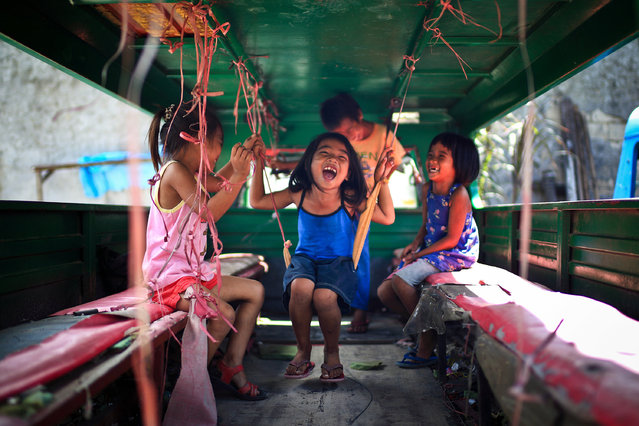 """Joyful"". Kids are enjoying themselves inside a Jeepney. Their smiles make me feel peaceful and joyful. I think this should be the pure happiness for them. Location: Cebu City, Philippines. (Photo and caption by Mac Kwan/National Geographic Traveler Photo Contest)"