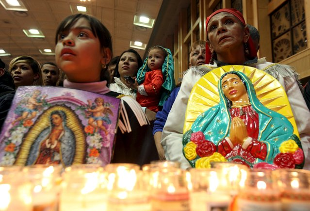 Pilgrims hold up images of the Virgin of Guadalupe during an annual pilgrimage in honor of the Virgin, the patron saint of Mexican Catholics, at the Cathedral of Ciudad Juarez, Mexico December 11, 2015. (Photo by Jose Luis Gonzalez/Reuters)
