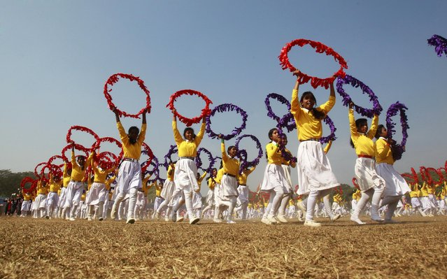 Schoolgirls perform during a Republic Day celebrations in the northeastern Indian city of Agartala January 26, 2015. (Photo by Jayanta Dey/Reuters)