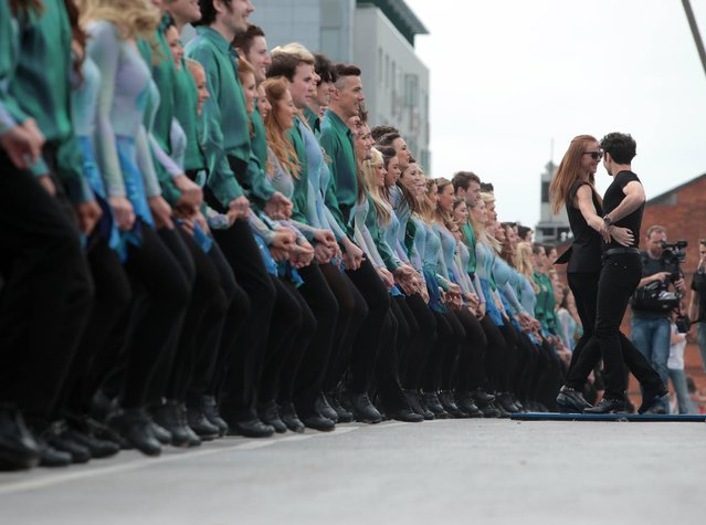 Jean Butler and Padriag Moyles with the dancers at the Riverdance Gathering longest line World Record attempt at the Sean O'Casey bridge over the Liffey in Dublin, on July 21, 2013. (Photo by Arthur Carron/Collins)