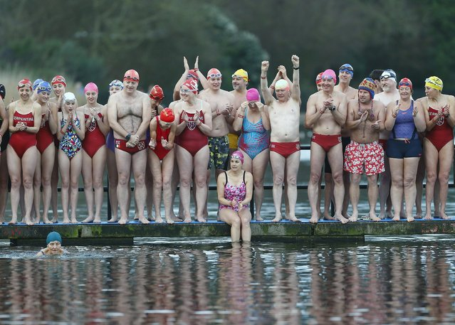Swimmers cheer as the first participant begins the annual Christmas Day Peter Pan Cup handicap race in the Serpentine River, in Hyde Park, London, December 25, 2015. (Photo by Andrew Winning/Reuters)