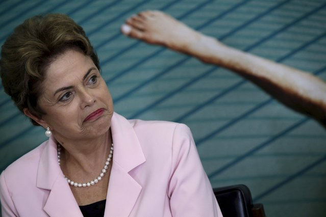 Brazil's President Dilma Rousseff, grappling with the deepest economic and political crisis in Brazil in decades, is also facing calls from opposition activists seeking the impeachment of Rousseff for mismanaging a once-booming economy and undermining confidence in the country. Pictured at the Planalto Palace in Brasilia, Brazil August 27, 2015. (Photo by Ueslei Marcelino/Reuters)