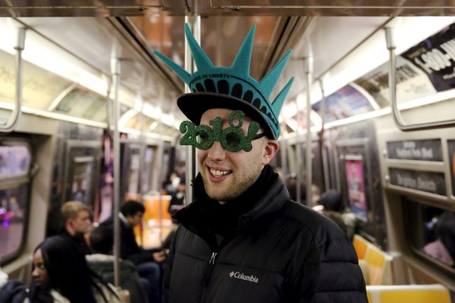Maxence Fombaron of Paris, France poses for a photo as he rides the subway to the New Year celebrations in Times Square in the Manhattan borough of New York December 31, 2015. (Photo by Andrew Kelly/Reuters)