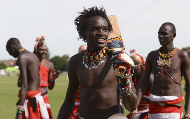 "Lesikito Christopher Memusi Ole Ngais (C) of the Maasai Cricket Warriors team from Kenya smiles after his team won a match against English team ""The Shed"" during ""The Last Man Stands"" cricket tournament at Dulwich sports ground in South London September 1, 2013. (Photo by Philip Brown/Reuters)"