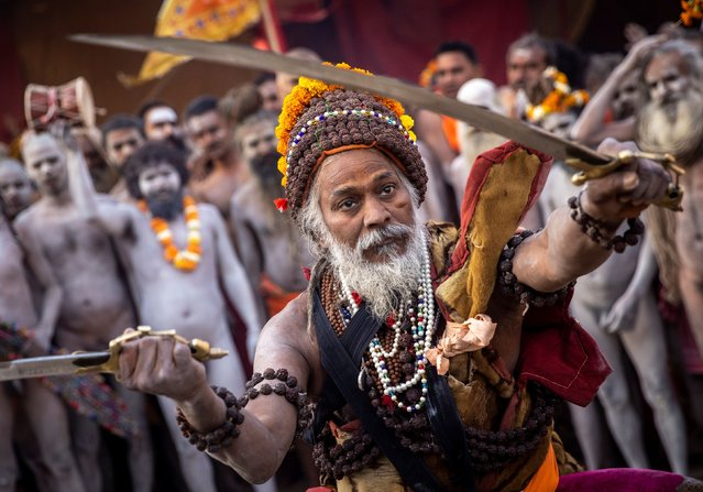 "Naga Sadhus, or Hindu holy men, participate in the procession for taking a dip in the Ganges river during Shahi Snan at ""Kumbh Mela"", or the Pitcher Festival, amidst the spread of the coronavirus disease (COVID-19), in Haridwar, India, April 12, 2021. (Photo by Danish Siddiqui/Reuters)"