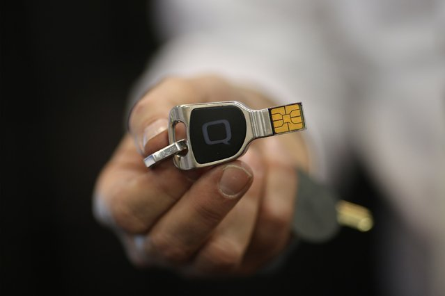 A Qkey, a removable security device for personal information to be used in online shopping, is shown at The CES Unveiled press event on January 4, 2016 in Las Vegas, Nevada ahead of the CES 2016 Consumer Electronics Show. CES, the annual consumer electronics and consumer technology tradeshow in Las Vegas boasts some 2.2 million net square feet (204,386 square meters) of exhibition space. (Photo by David McNew/AFP Photo)