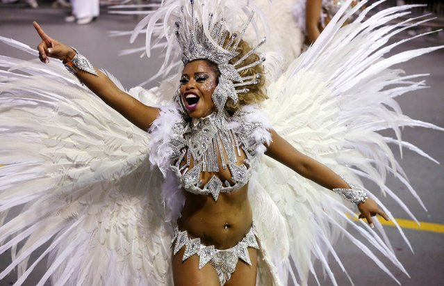 A reveller from the Vai-Vai Samba School takes part in a carnival at Anhembi Sambadrome in Sao Paulo, February 15, 2015. (Photo by Paulo Whitaker/Reuters)