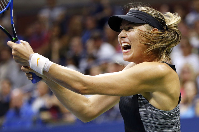 Maria Sharapova, of Russia, returns a shot to Carla Suarez Navarro, of Spain, during the fourth round of the U.S. Open tennis tournament, Monday, September 3, 2018, in New York. (Photo by Jason DeCrow/AP Photo)