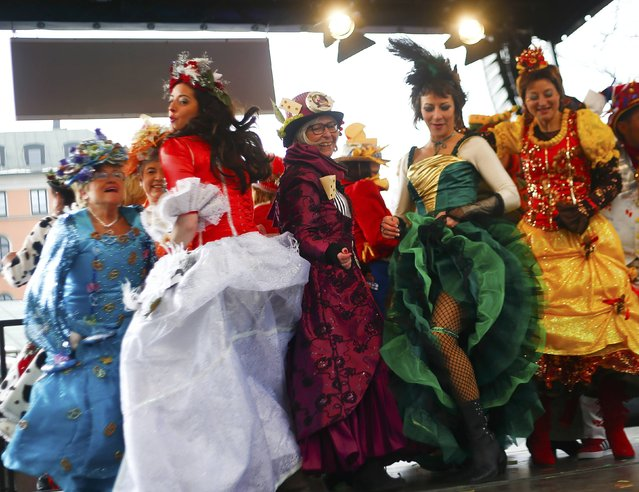 """Female traders of Munich's famous street market the Viktualienmarkt, dance in colourful dresses to celebrate the traditional """"Dance of the Market-Women"""" carnival event in Munich February 17, 2015. (Photo by Michael Dalder/Reuters)"""