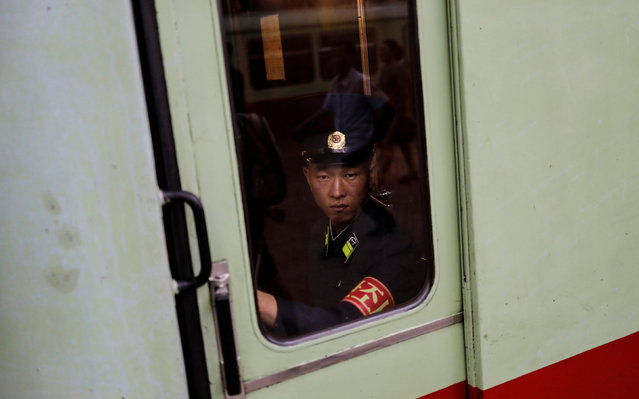 A railway worker sits in his cabin as a train leaves a subway station in Pyongyang, North Korea on September 11, 2018. (Photo by Danish Siddiqui/Reuters)