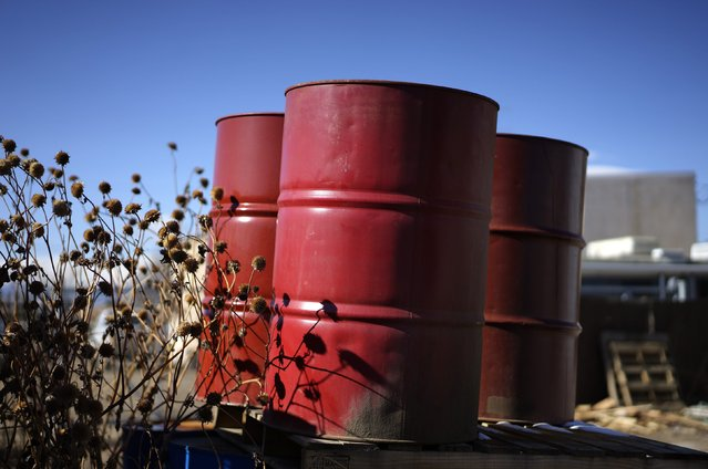 Oil barrels sit empty at a recycling yard in Longmont, Colorado February 2, 2015. (Photo by Rick Wilking/Reuters)